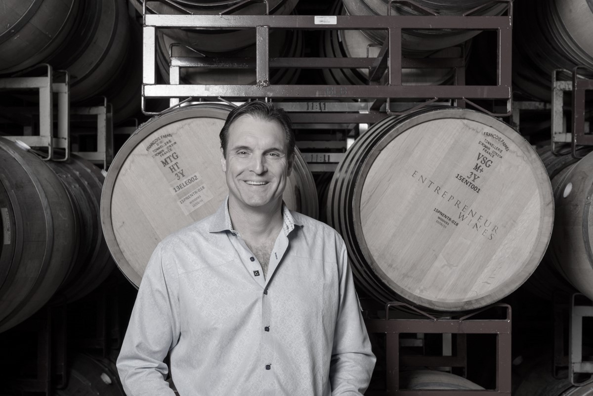 Mike Metzker, proprietor and founder, standing in the barrel hall of the Napa Valley winemaking facility.
